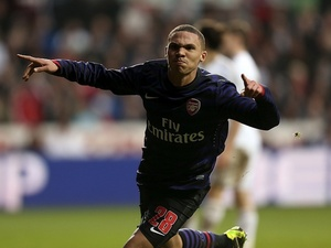 Arsenal 's Kieran Gibbs celebrates the second goal against Swansea on January 6, 2013