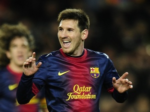 Lionel Messi celebrates Barca's fourth goal against Espanyol on January 6, 2013
