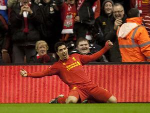 Liverpool striker Luis Suarez celebrates scoring his first goal against Sunderland on January 2, 2013