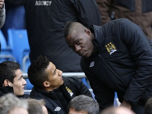 Controversial City forward Mario Balotelli takes his place on the bench against Watford on January 5, 2013