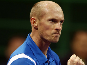 Nikolay Davydenko celebrates his win over David Ferrer in the Qatar Open on January 4, - nikolay-davydenko