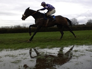 A waterlogged race track being ridden over by Pardini on December 11, 2006