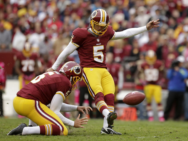 Billy Cundiff of the Washington Redskins takes a kick in a game on October 7, 2012