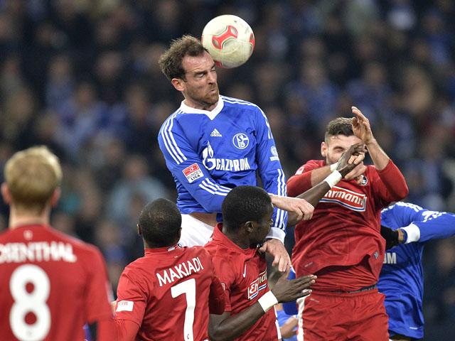Schalke's Christoph Metzelder heads the ball on December 15, 2012