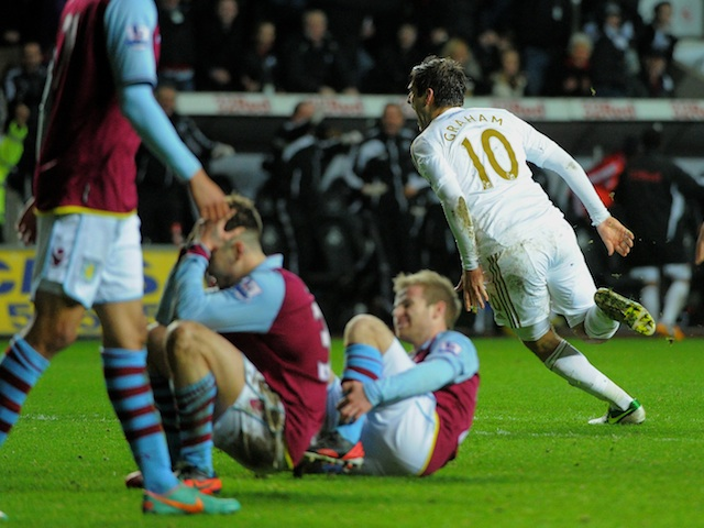 Swansea striker Danny Graham celebrates his late equaliser against Aston Villa on January 1, 2013