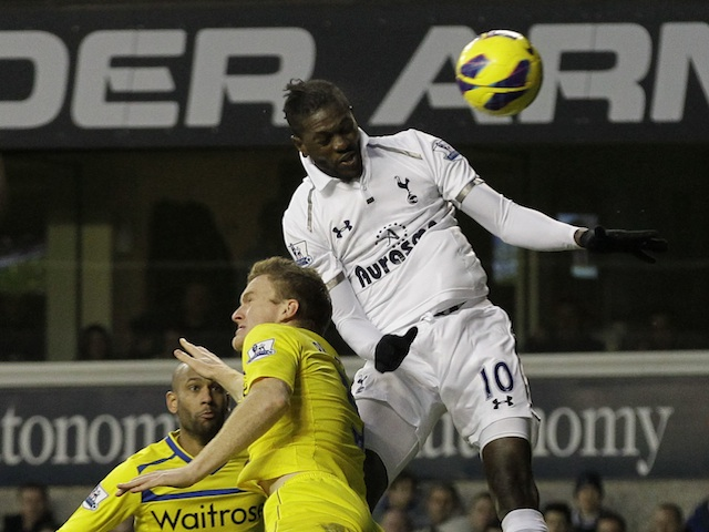 Spurs striker Manu Adebayor leaps to score a header against Reading on January 1, 2013