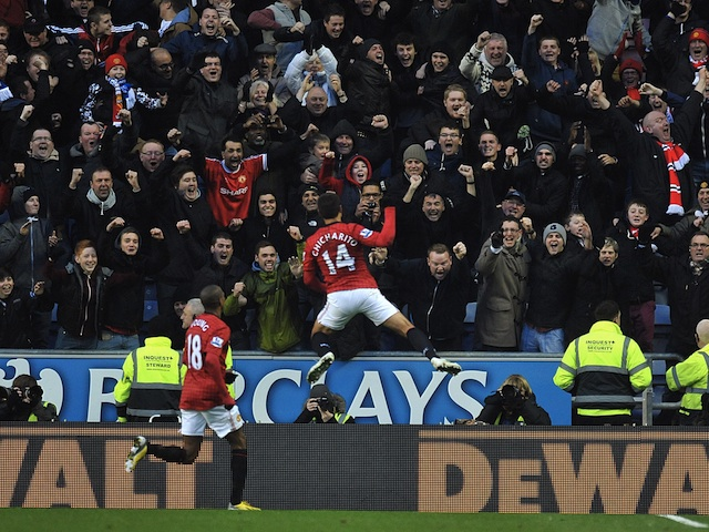 Man Utd forward Javier Hernandez celebrates his opener against Wigan on January 1, 2013