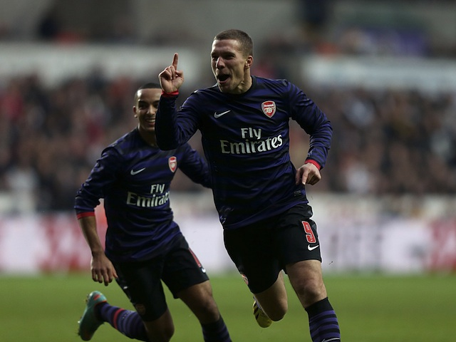 Lukas Podolski celebrates scoring Arsenal's first goal against Swansea on January 6, 2013