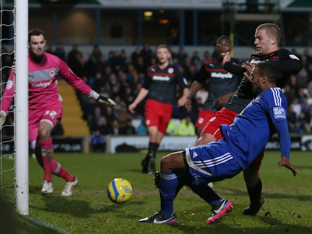 Macclesfield striker Matthew Barnes-Homer scores the equaliser against Championship leaders Cardiff on January 5, 2013