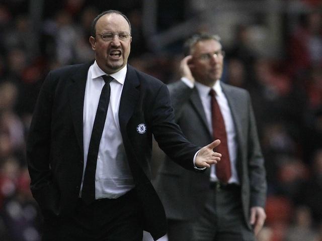 Chelsea manager Rafa Benitez stands in front of Saints boss Nigel Adkins on January 5, 2013