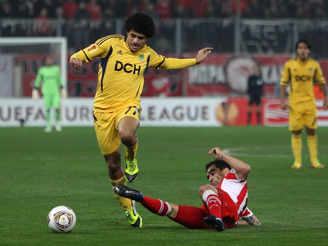 Taison of Metalist Kharkiv is challenged during their Europa League second leg tie on March 15, 2012