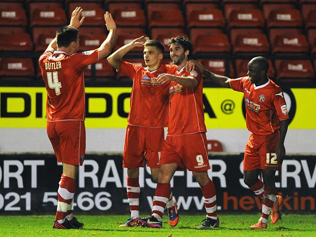 Walsall's Will Grigg celebrates with team mates after scoring his team's second goal against Portsmouth on January 4, 2013
