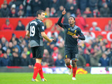 Forward Daniel Sturridge celebrates scoring his first league goal for Liverpool in their match against Manchester United on January 13, 2013