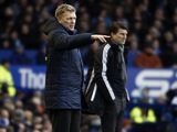 Opposing managers David Moyes and Michael Laudrup on the touchline during the game between Everton and Swansea on January 12, 2013