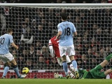 City forward Edin Dzeko taps in the second goal against Arsenal on January 13, 2013