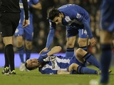 Wigan defender Ivan Ramis lays down injured in the match against Fulham on January 12, 2013