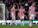 Jonathan Walters is consoled by his team mate Ryan Shawcross after scoring an own goal against Chelsea on January 12, 2013