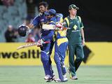 Lahiru Thirimanne (left) celebrates scoring a century for Sri Lanka against Australia on 13 January, 2013