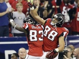 Atlanta TE Tony Gonzalez celebrates the first touchdown of the game against Seattle on January 13, 2013