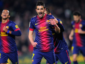 Barcelona's David Villa is congratulated by team mates after scoring against Cordoba on January 10, 2013