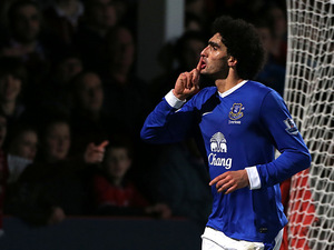 Marouane Fellaini celebrates scoring Everton's fifth goal against Cheltenham in the FA Cup on January 7, 2013