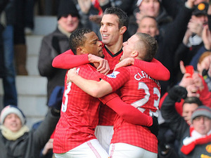Manchester United striker Robin van Persie celebrates with teammates during his sides match against Liverpool on 13 January, 2013