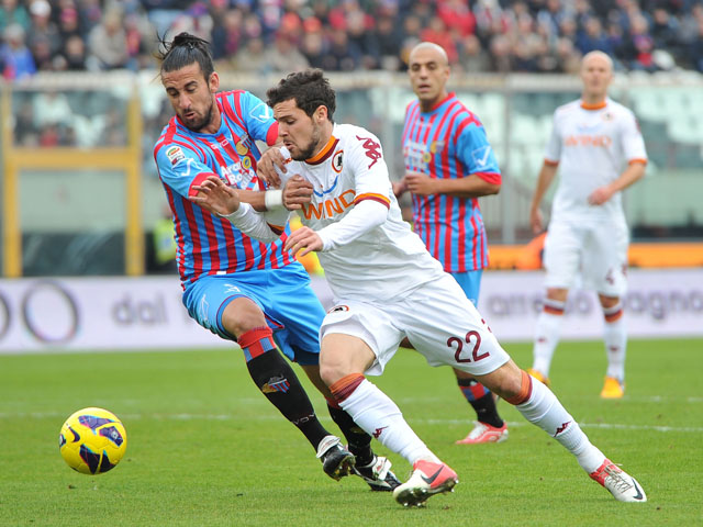 Mattia Destro of AS Roma challenges for the ball in his sides Serie A clash with Catania on January 13, 2013