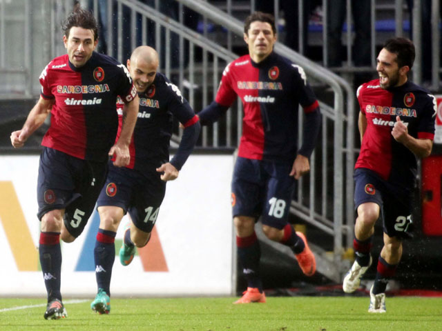 Daniele Conti celebrates scoring Cagliari's second goal in their Serie A match against Genoa on January 13, 2013