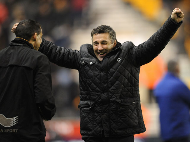 New Wolverhampton Wanderers manager Dean Saunders celebrates his teams equaliser against Blackburn Rovers on January 11, 2013