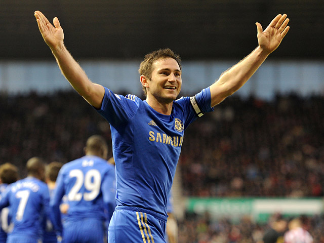 Frank Lampard celebrates scoring his team's third goal after converting a penalty against Stoke on January 12, 2013