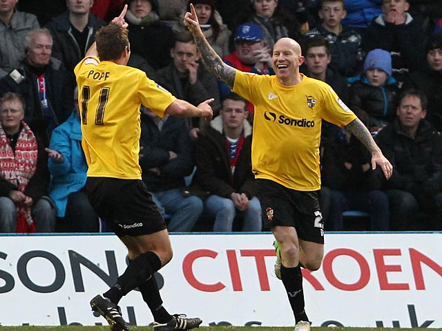 Port Vale's Lee Hughes is congratulated by team mate Tom Pope after scoring his team's second goal against Gillingham on January 12, 2013