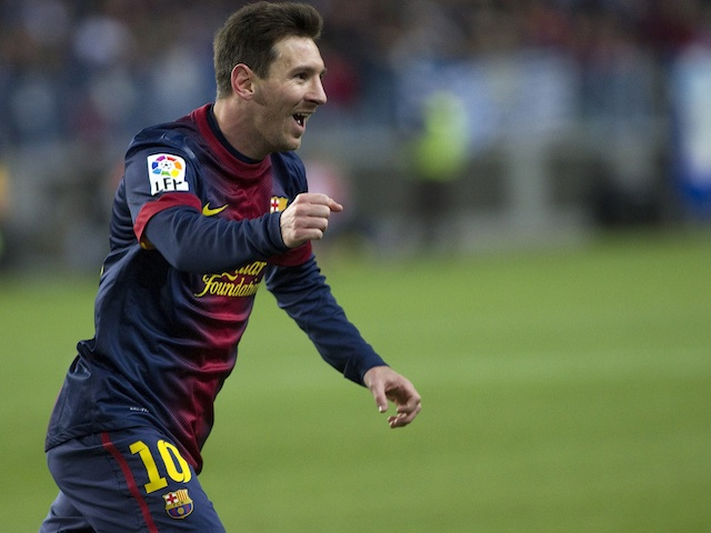 Lionel Messi celebrates a goal for Barcelona in the game against Malaga on January 13, 2013