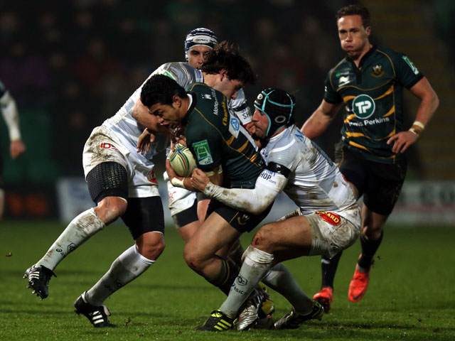Northampton's George Pisi is tackled during his teams Heineken Cup match on 11 January, 2013