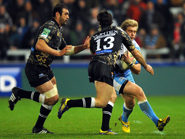 Charlie Amesbury of Sale Sharks is tackled by two Montpellier players during thier match on January 11, 2013