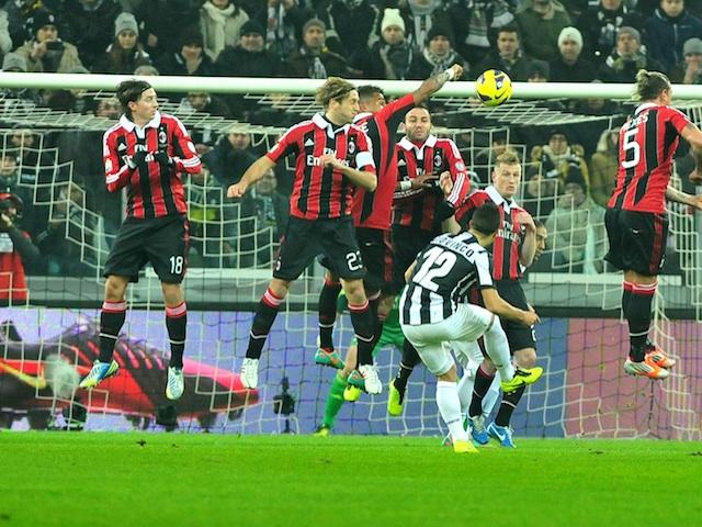 Juve's Sebastian Giovinco scores a free-kick against Milan on January 9, 2013