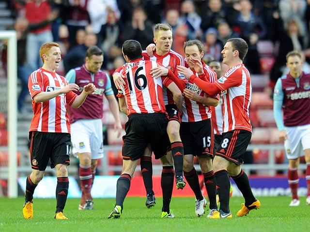 Sebastian Larsson is congratulated by team mates after scoring the opener against West Ham on January 12, 2013