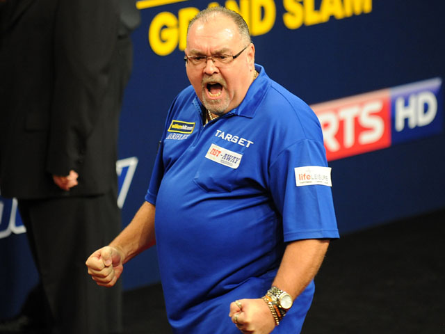 Tony O'Shea celebrates during his match with Gary Anderson on 12 November, 2012