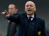Chievo coach Eugenio Corini gestures to his players during the match against Parma on January 20, 2013