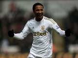 Swansea's Jonathan de Guzman celebrates one of his two goals against Stoke on January 19, 2013