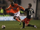 Blackpool's Ludovic Sylvestre battles Cardiff's Aaron Gunnarsson for possession on January 19, 2013