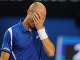 Nikolay Davydenko reacts during his defeat to Roger Federer at the Australian Open on January 17, 2013