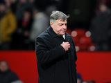 West Ham manager Sam Allardyce leaves the field at the final whistle after losing against Manchester United during the FA Cup third round replay on January 16, 2013