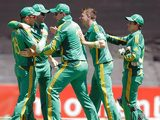 Graeme Smith is congratulated by his team after taking the wicket of New Zealand's Martin Guptill during a One Day International game on January 19, 2013
