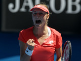 Russia's Ekaterina Makarova celebrates winning the first set against Angelique Kerber in the fourth round of the Australian Open tennis championship on January 20, 2013