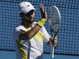 Spain's Fernando Verdasco reacts after his first round victory in the Australian Open tennis championship on January 14, 2013