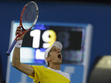 Jarkko Nieminen celebrates defeating Tommy Haas in five-sets at the Australian Open tennis championship on January 15, 2013