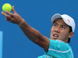 Kei Nishikori of Japan makes a serve during his first round match at the Australian Open tennis championship on January 14, 2013
