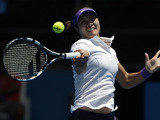 China's Li Na hits a return in her second round match at the Australian Open tennis championship on January 16, 2013