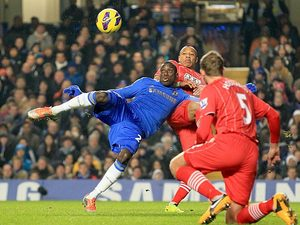 Demba Ba strikes the ball to score the opener against Southampton on January 16, 2013