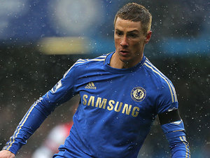 Chelsea's Fernando Torres sporting a new haircut in action during the match against Arsenal on January 20 , 2013